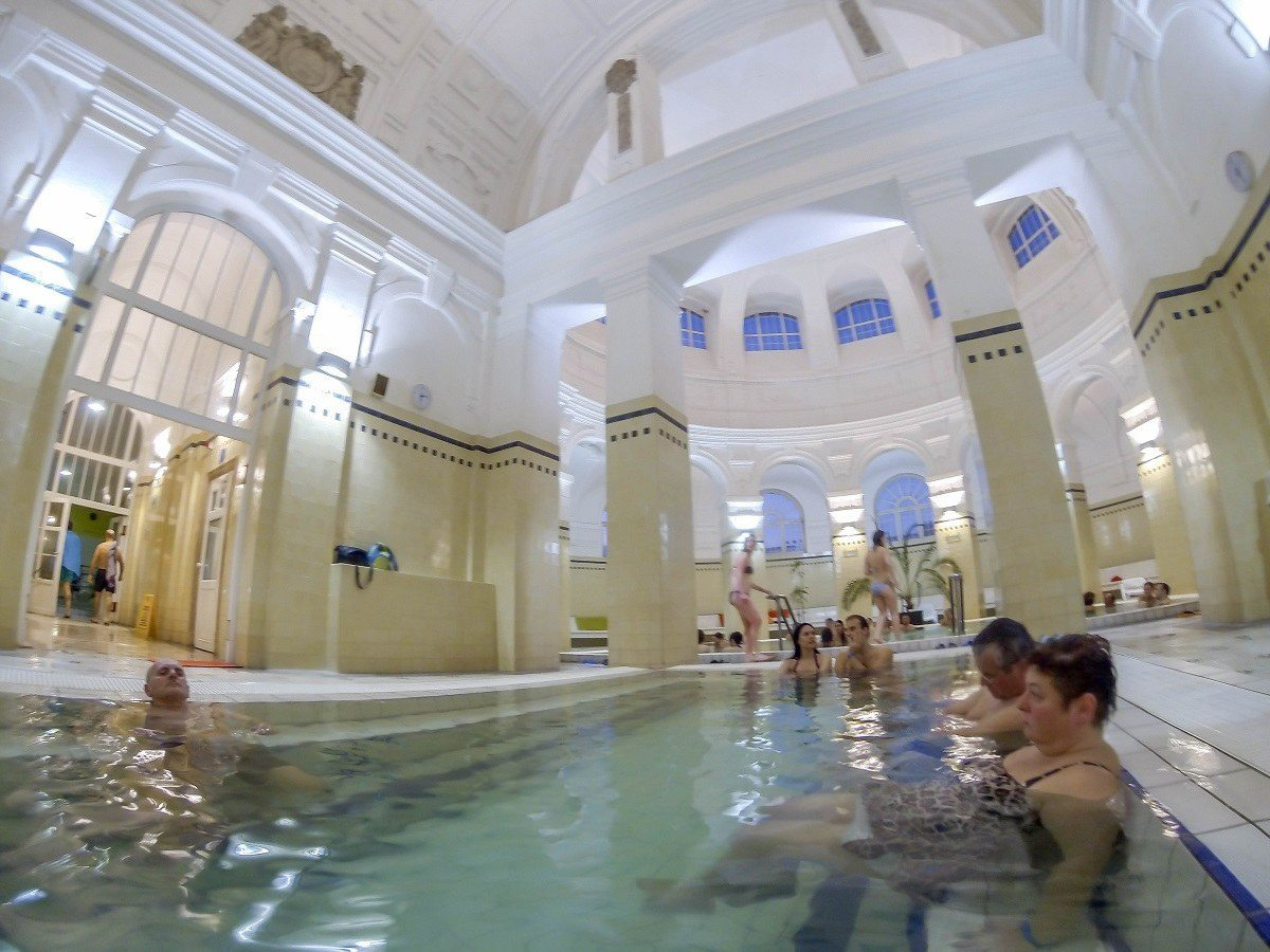 People in the indoor thermal pools at the Szechenyi Spa