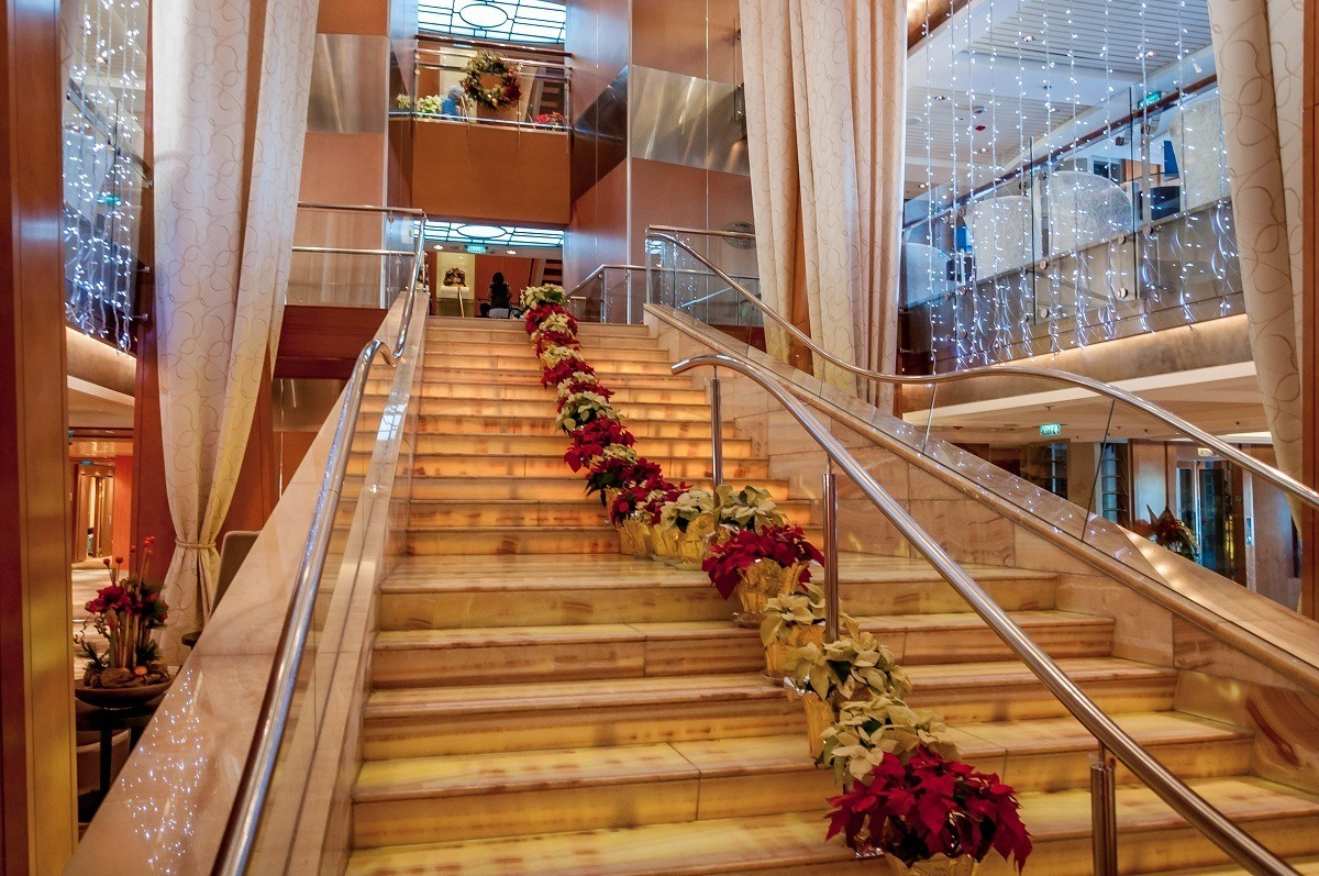The main staircase of the ship lined with poinsettias