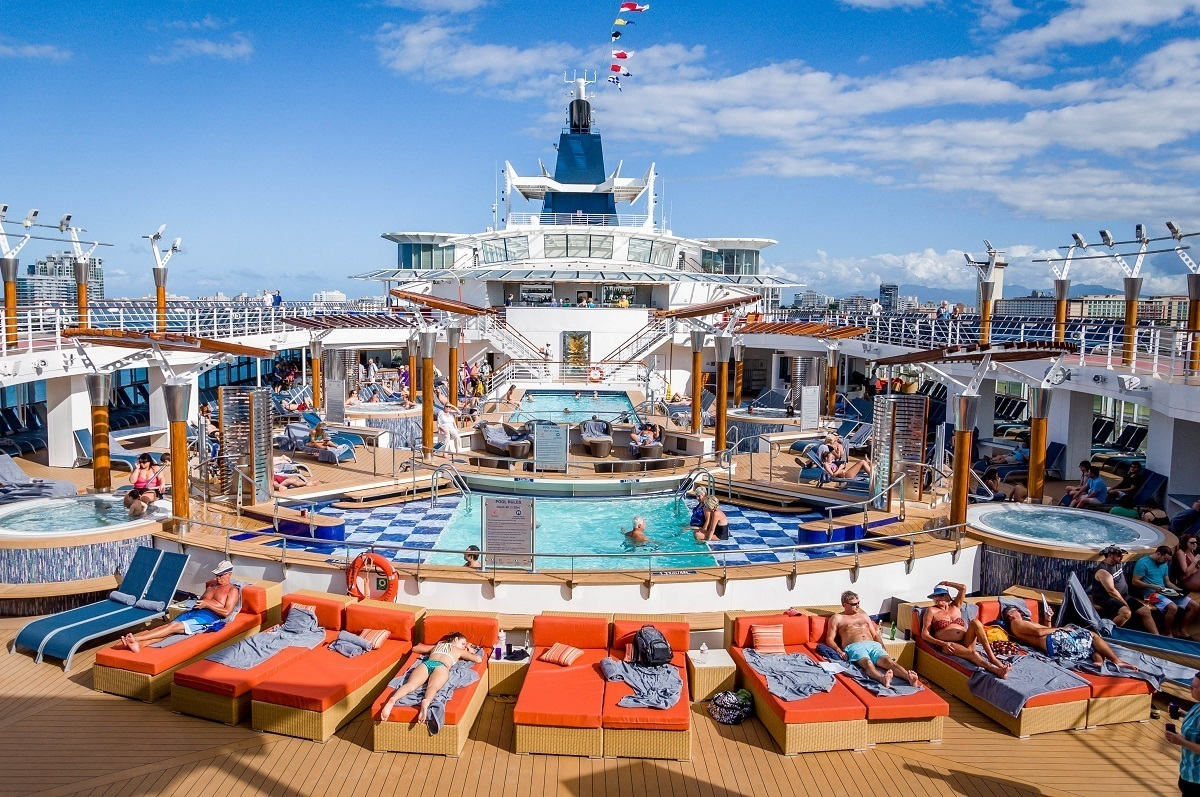 The outdoor pool deck on a Celebrity Summit cruise