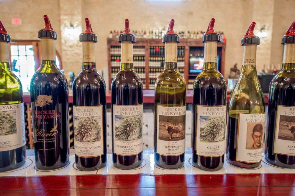 Wine bottles from Becker vineyard lined up on a bar