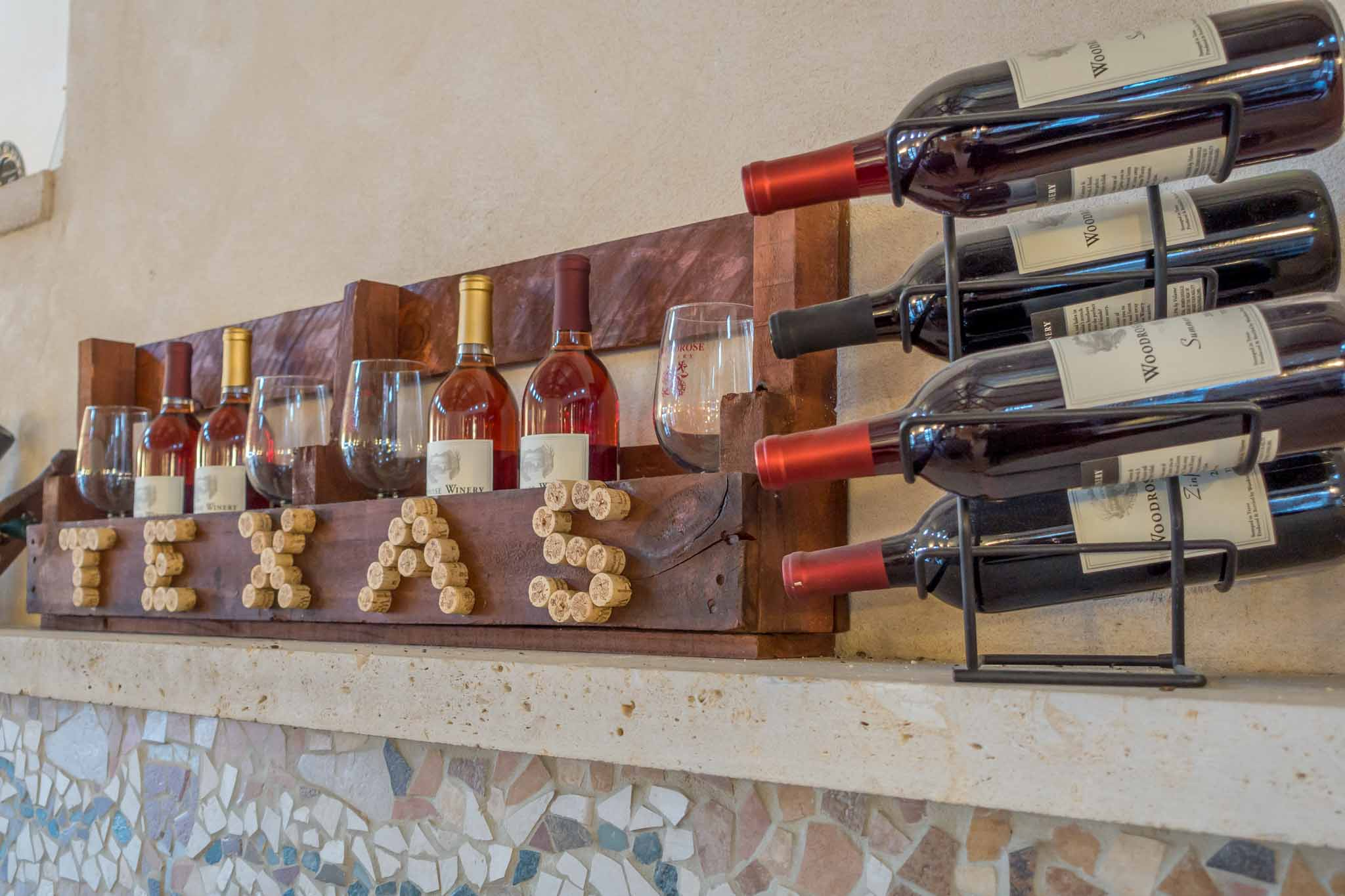Display of wine bottles, glasses, and corks