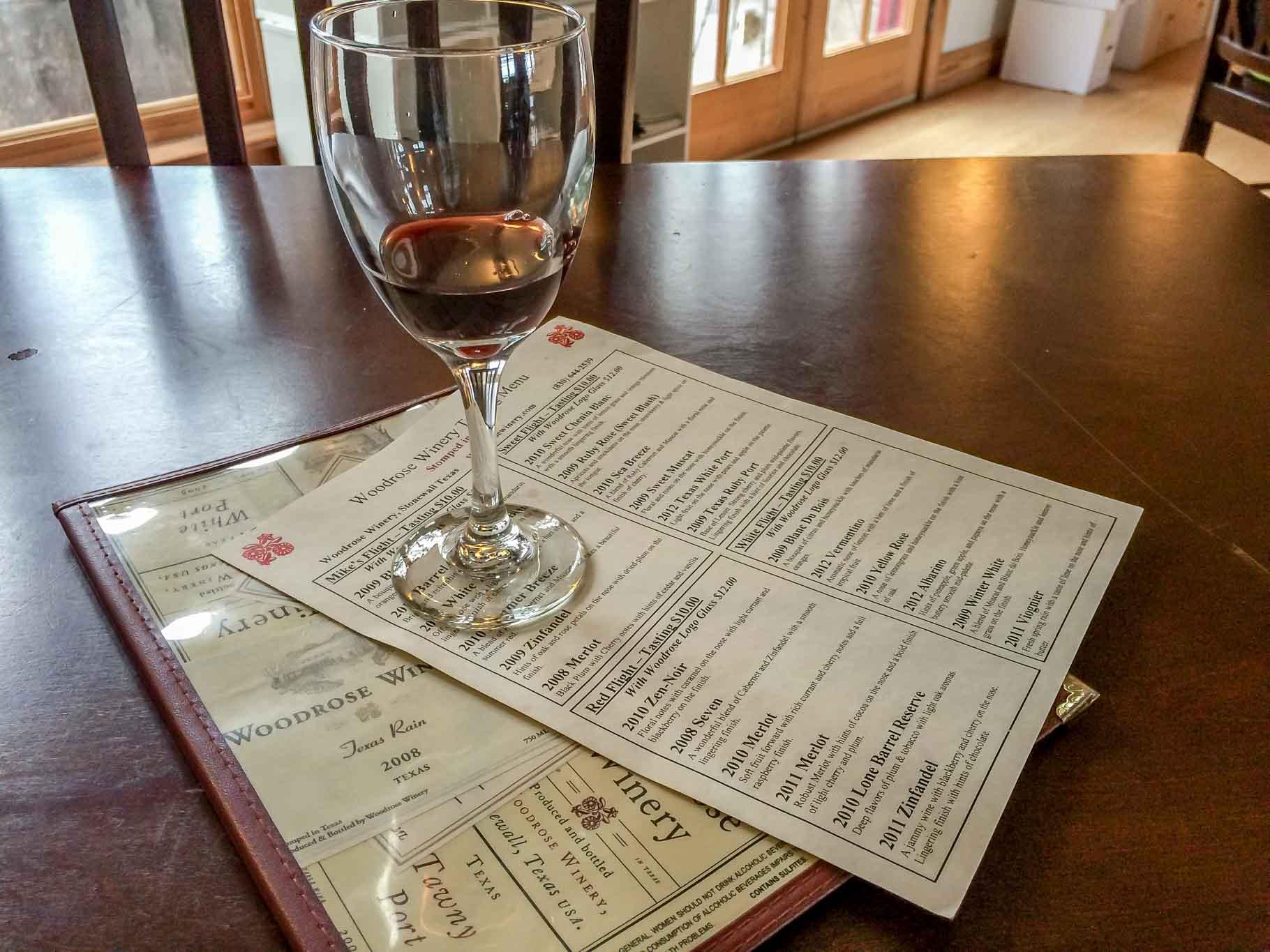 Wine glass and tasting menu