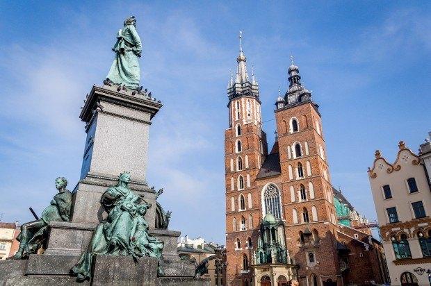 Statue beside a church in a city square
