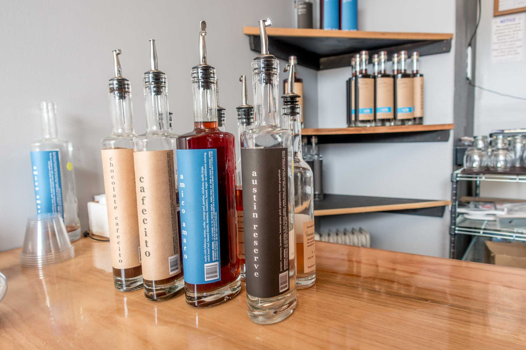Revolution Spirits' gins and liqueur bottles on bar