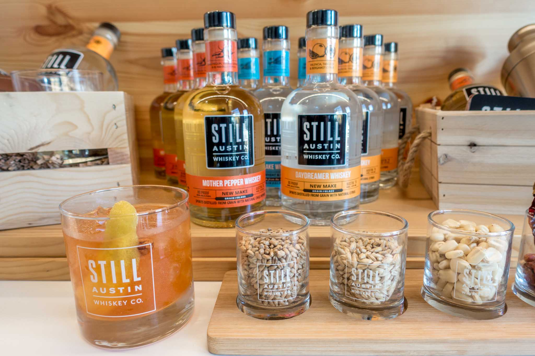 Bottles and cocktail at Still Austin Whiskey Co