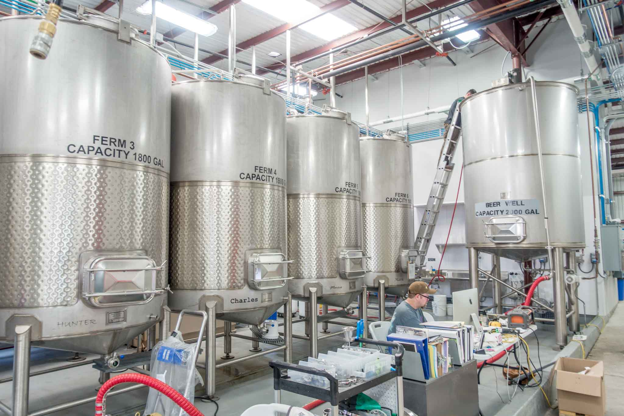 Steel fermentation tanks at a distillery
