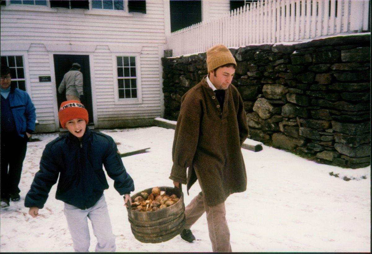 Lance carrying vegetables at the Sturbridge Village
