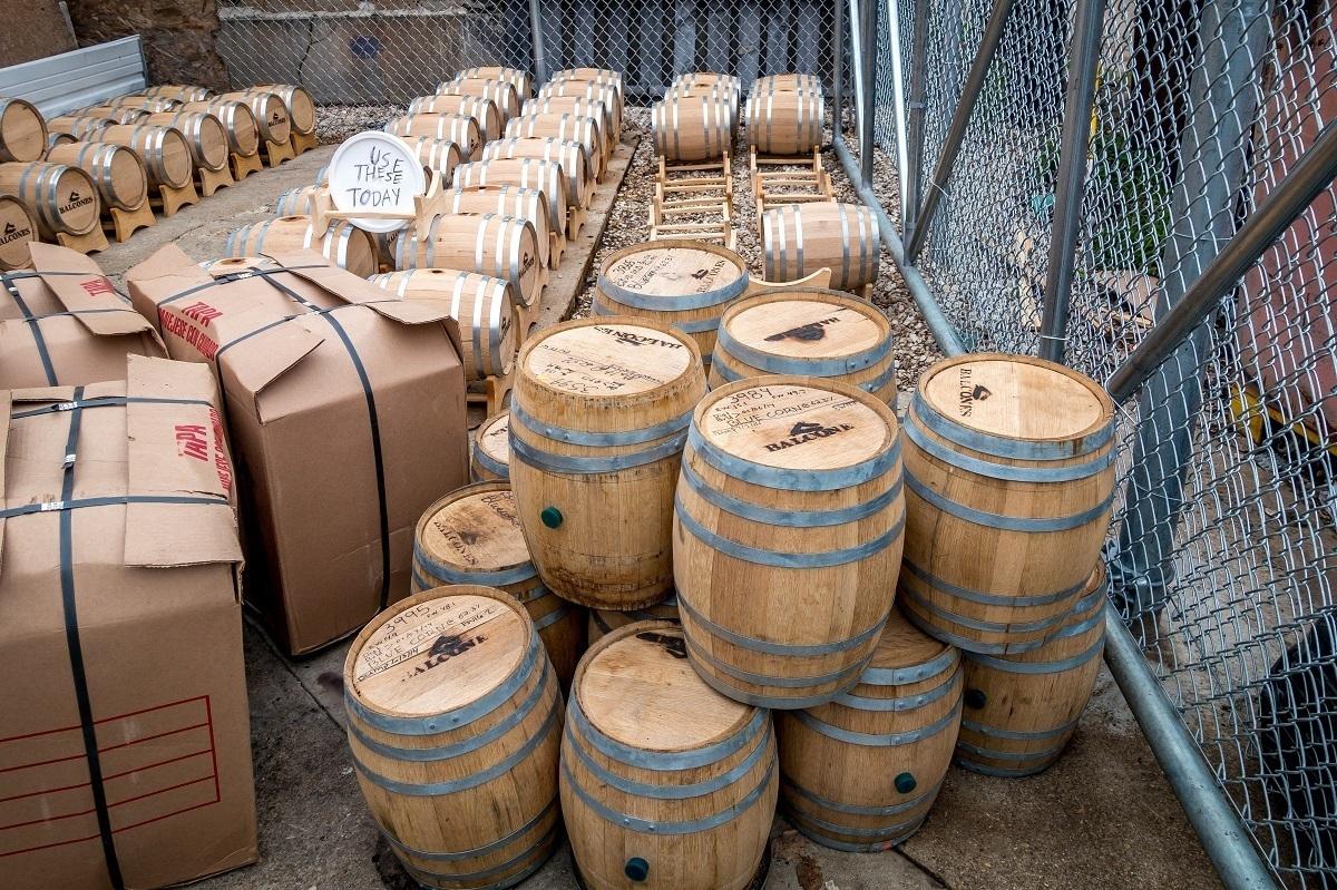 Five-gallon whiskey barrels outside