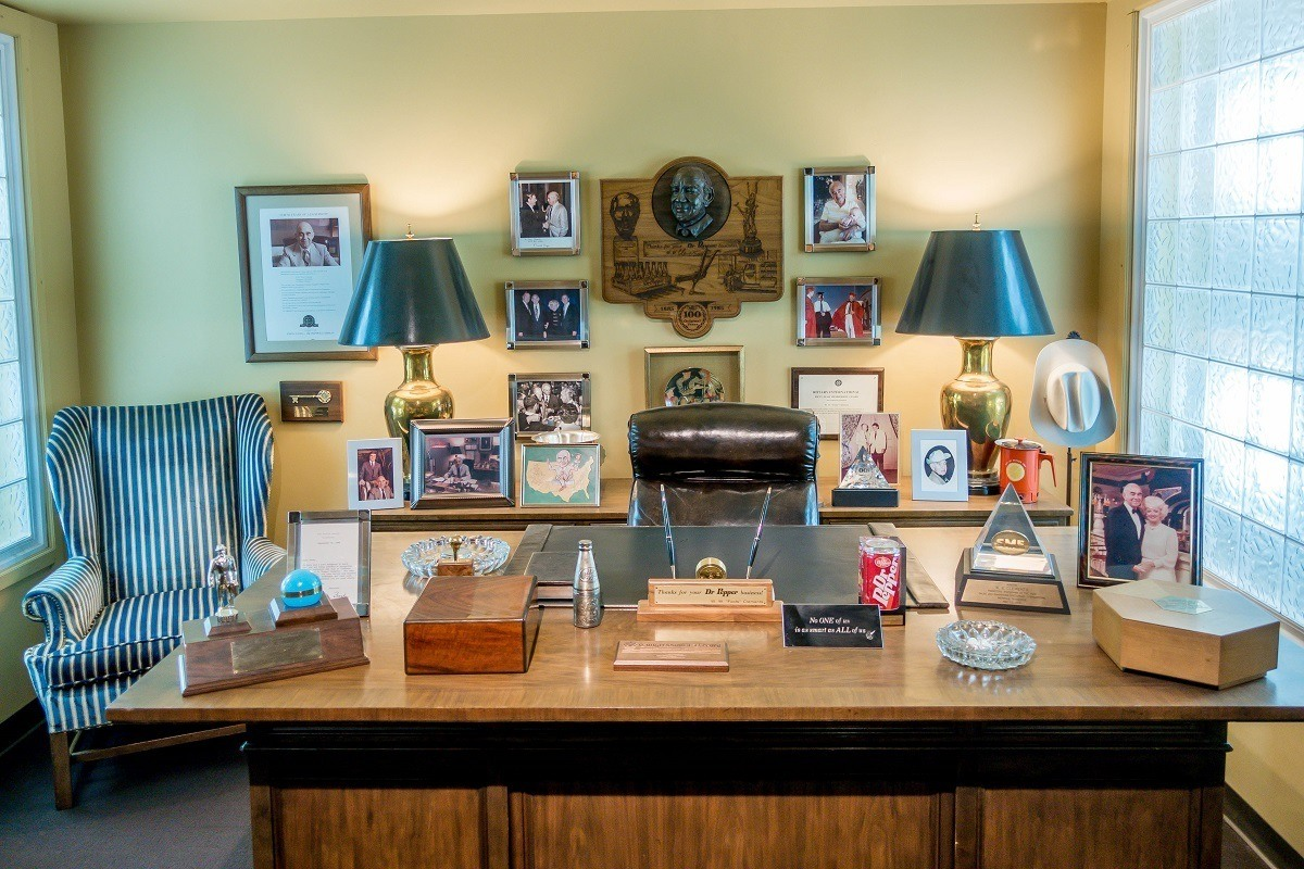 Desk and framed photos belonging to Foots Clements at the Dr Pepper museum