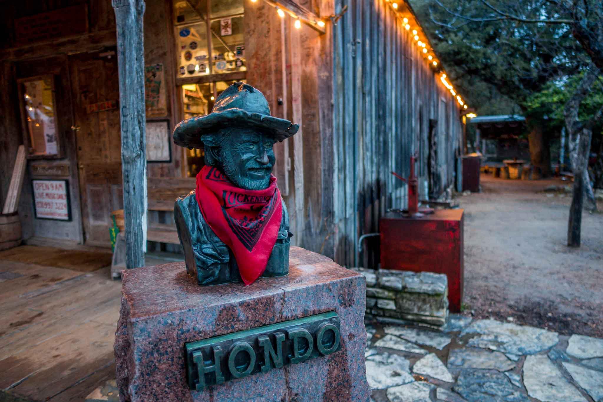 Small bust of Hondo Crouch wearing bandana