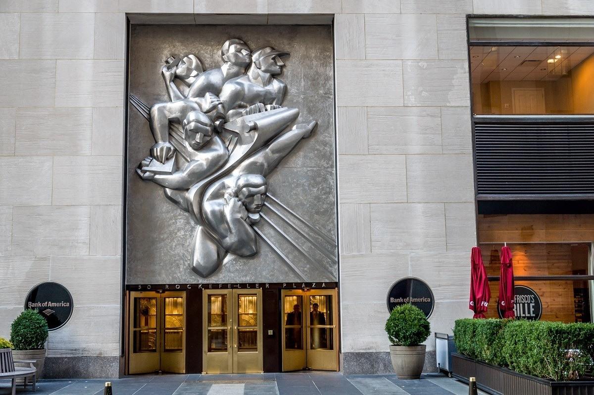 News, a massive sculpture featuring five men