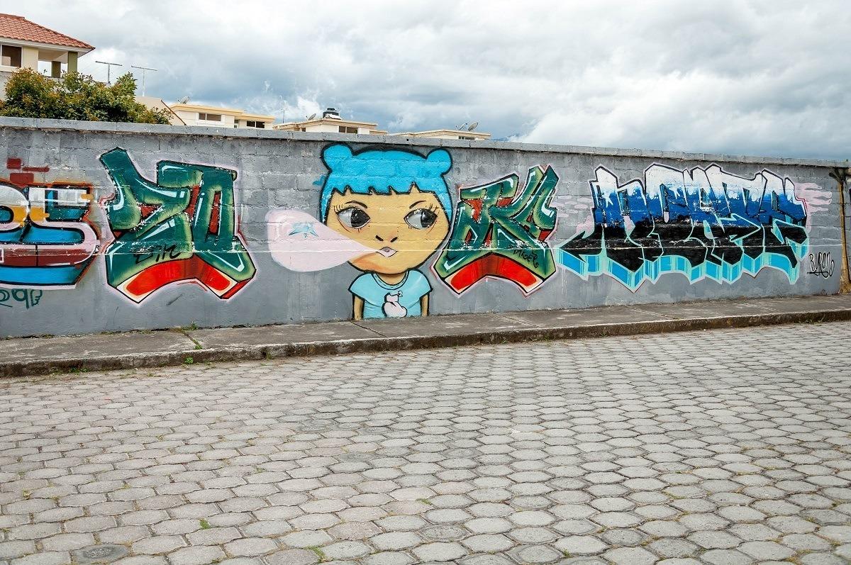 Graffiti mural of girl in Cotacachi