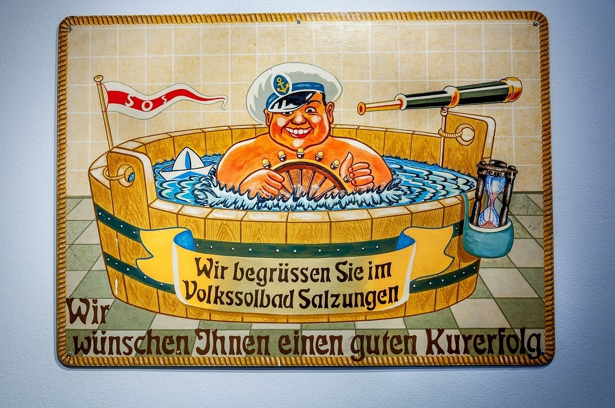 Vintage advertisement of a man in a bath