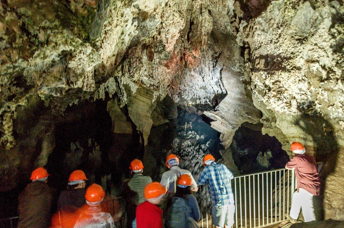 A group of visitors exploring inside the Sterkfontein Cave