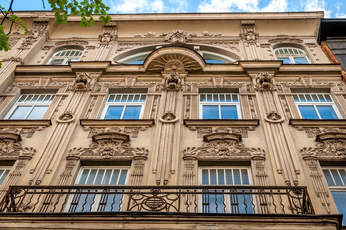 Sun with a face and other decorations carved into building's facade