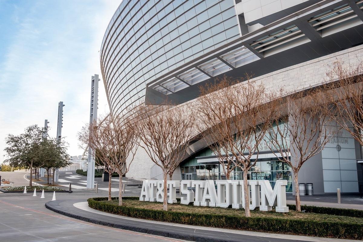 """Exterior of stadium and """"AT&T Stadium"""" sign"""