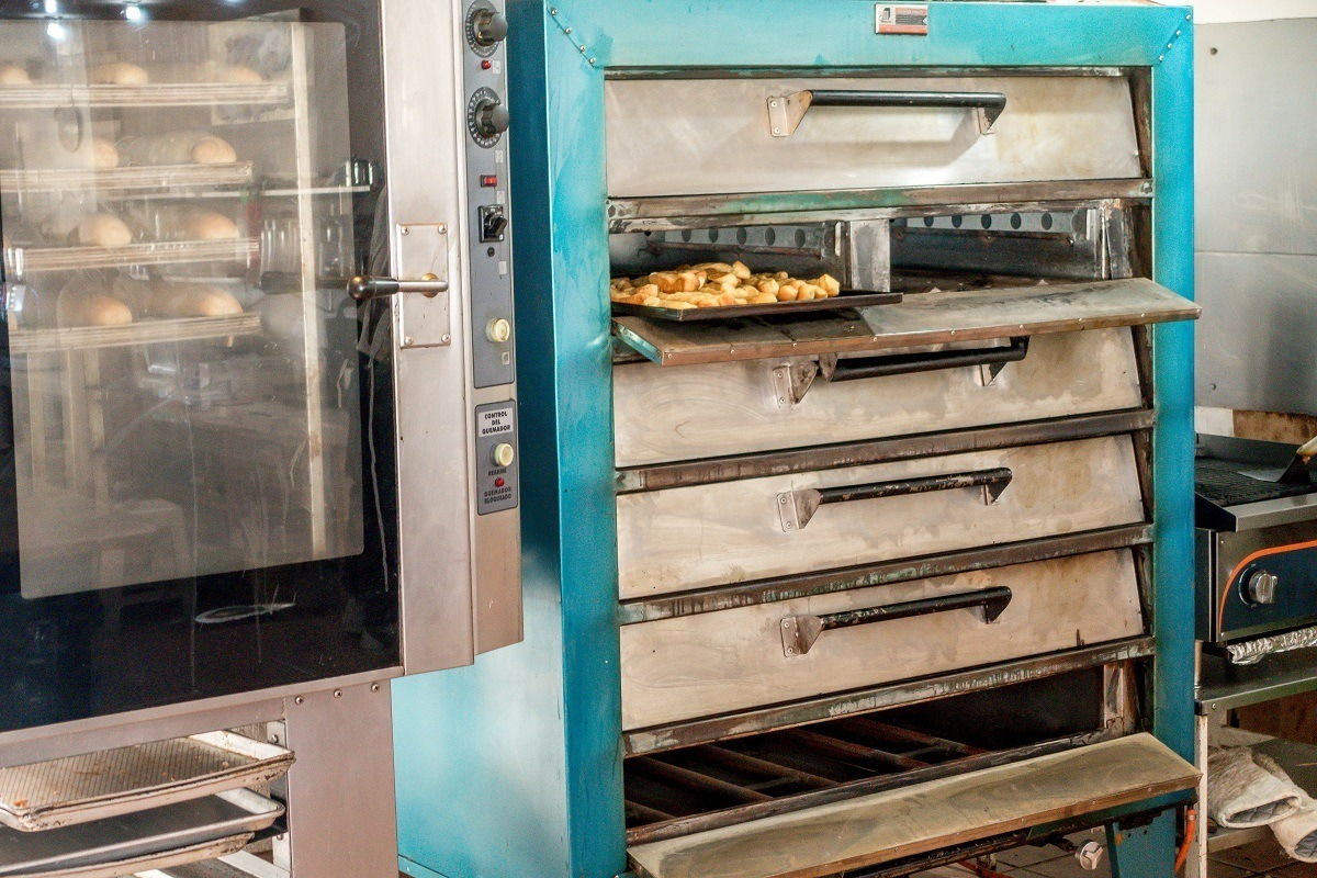 Bizcochos baking in a large commercial oven
