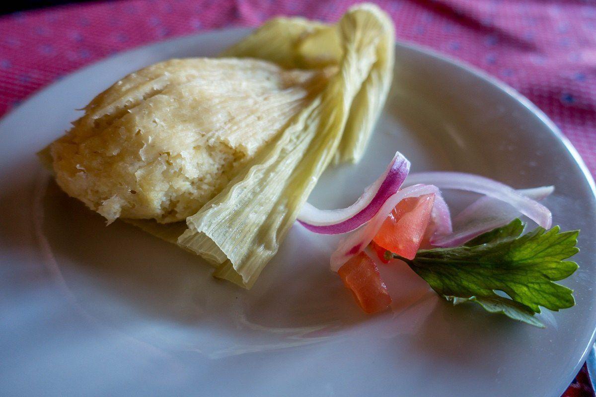 Humita, steamed masa and corn in a cork husk