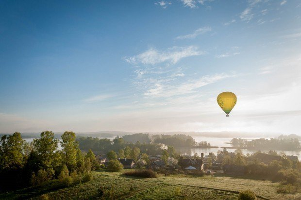 Hot air balloon above the countryside