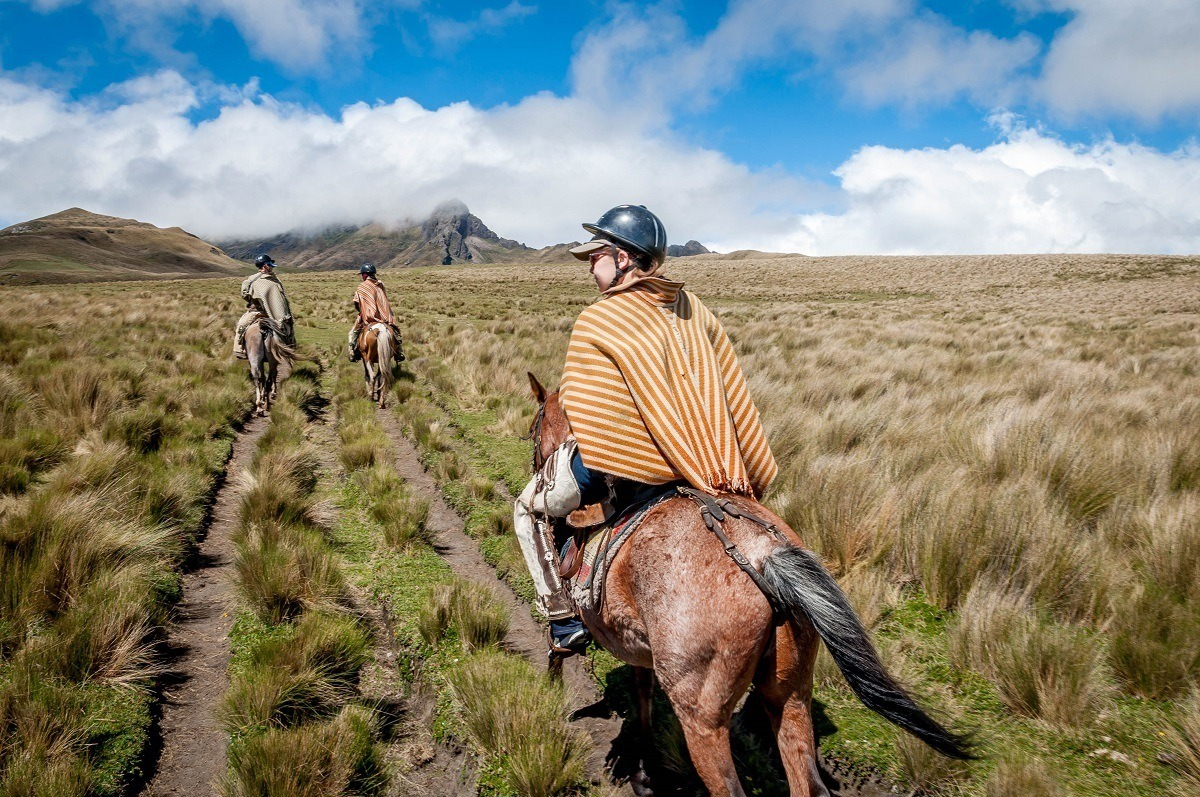 Laura and our guides horseback riding in the Avenue of the Volcanoes on Rumiñahui