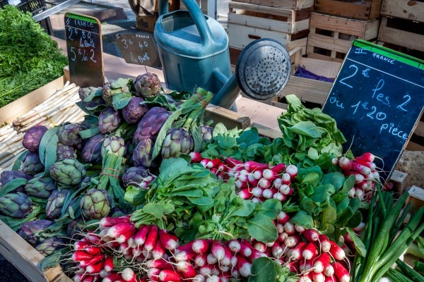 Radishes and artichokes at a Provence market