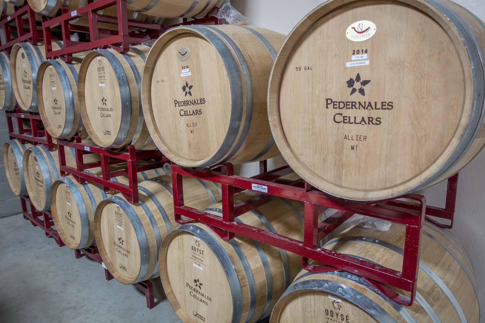 Stacked wine barrels at Pedernales Cellars