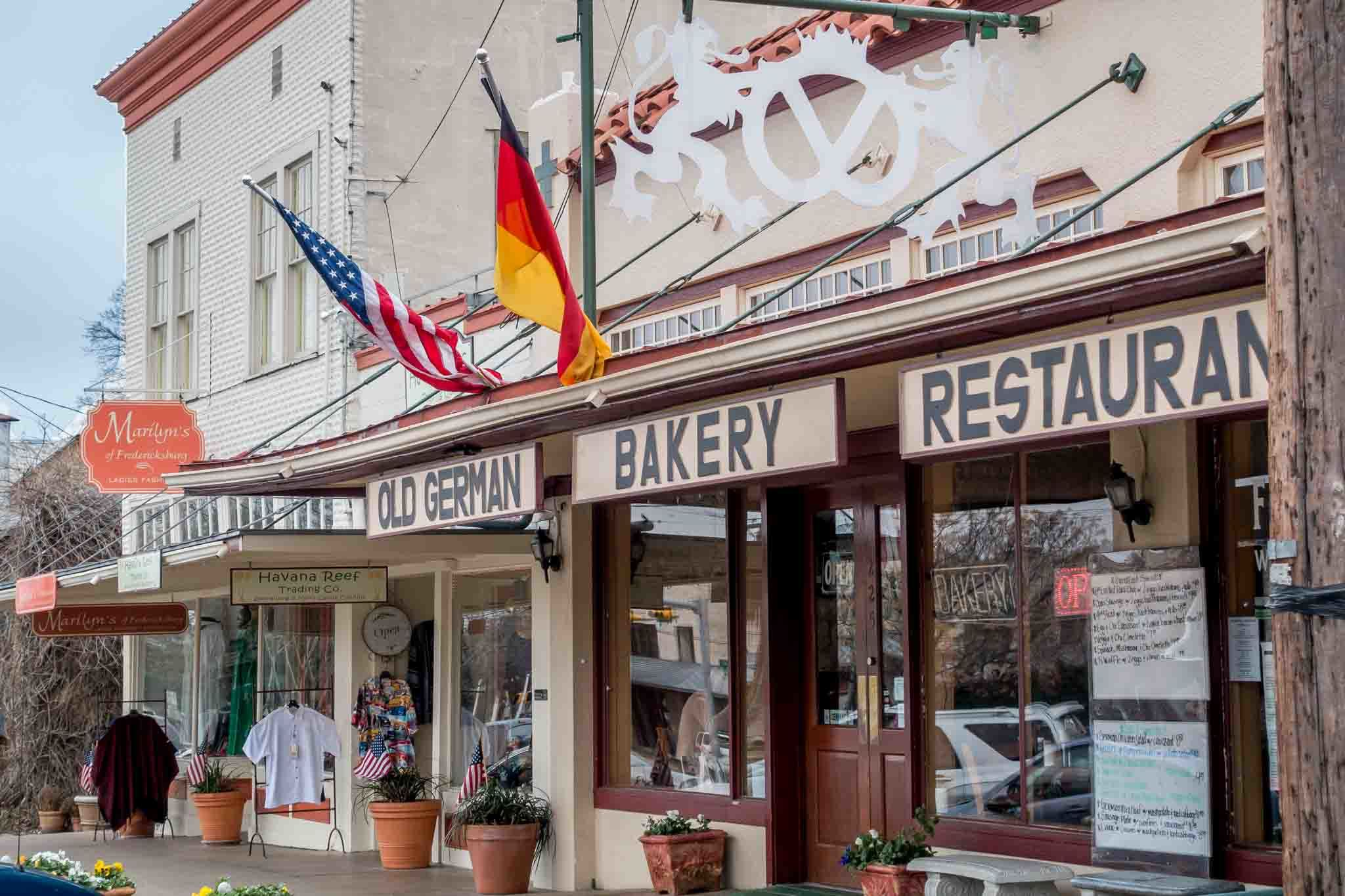 Storefront for Old German Bakery & Restaurant flying German and American flags
