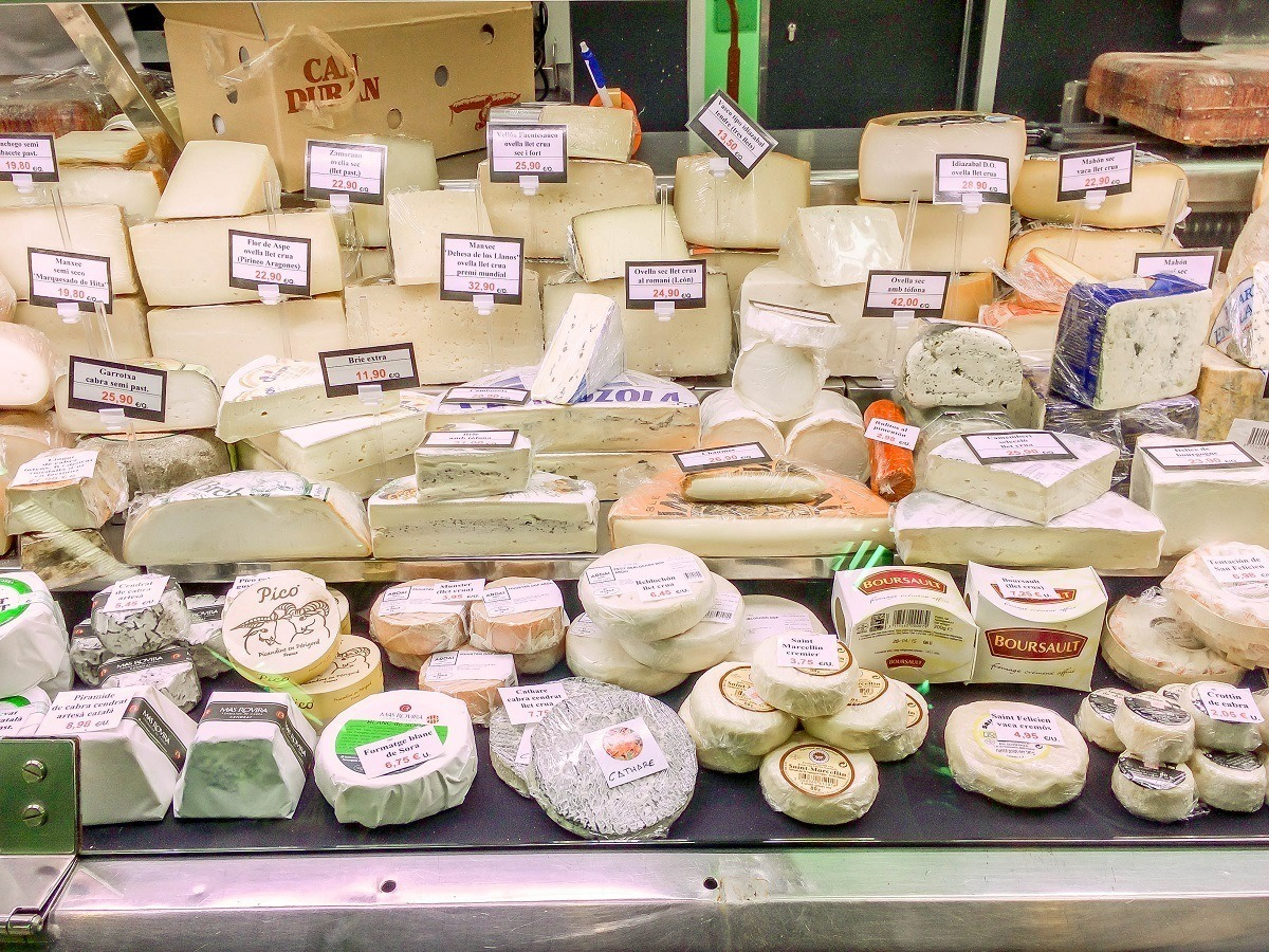 A wide variety of cheeses in the Mercat de l'Abaceria Central in Barcelona