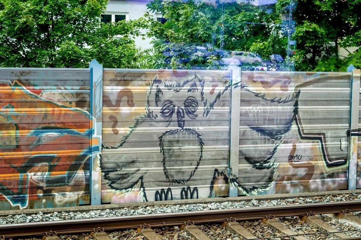 Nuremberg street art of an owl by the railway tracks