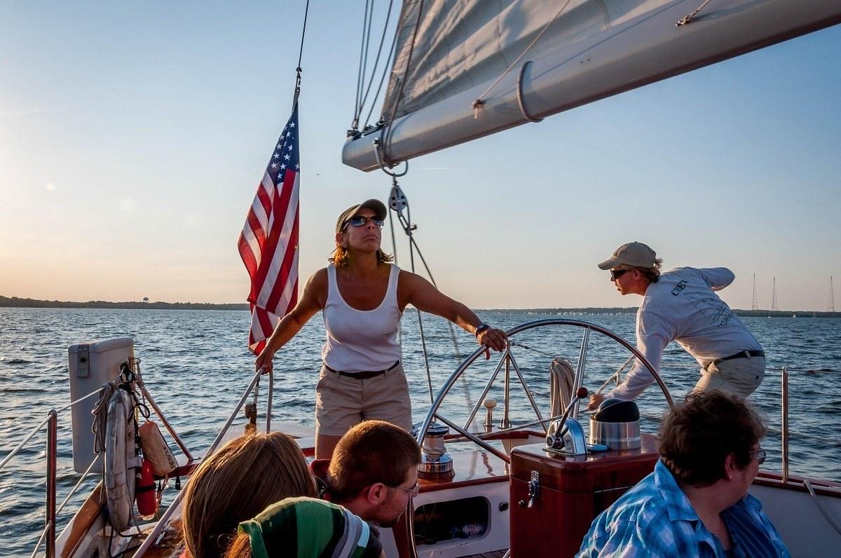 Captain sailing sailboat