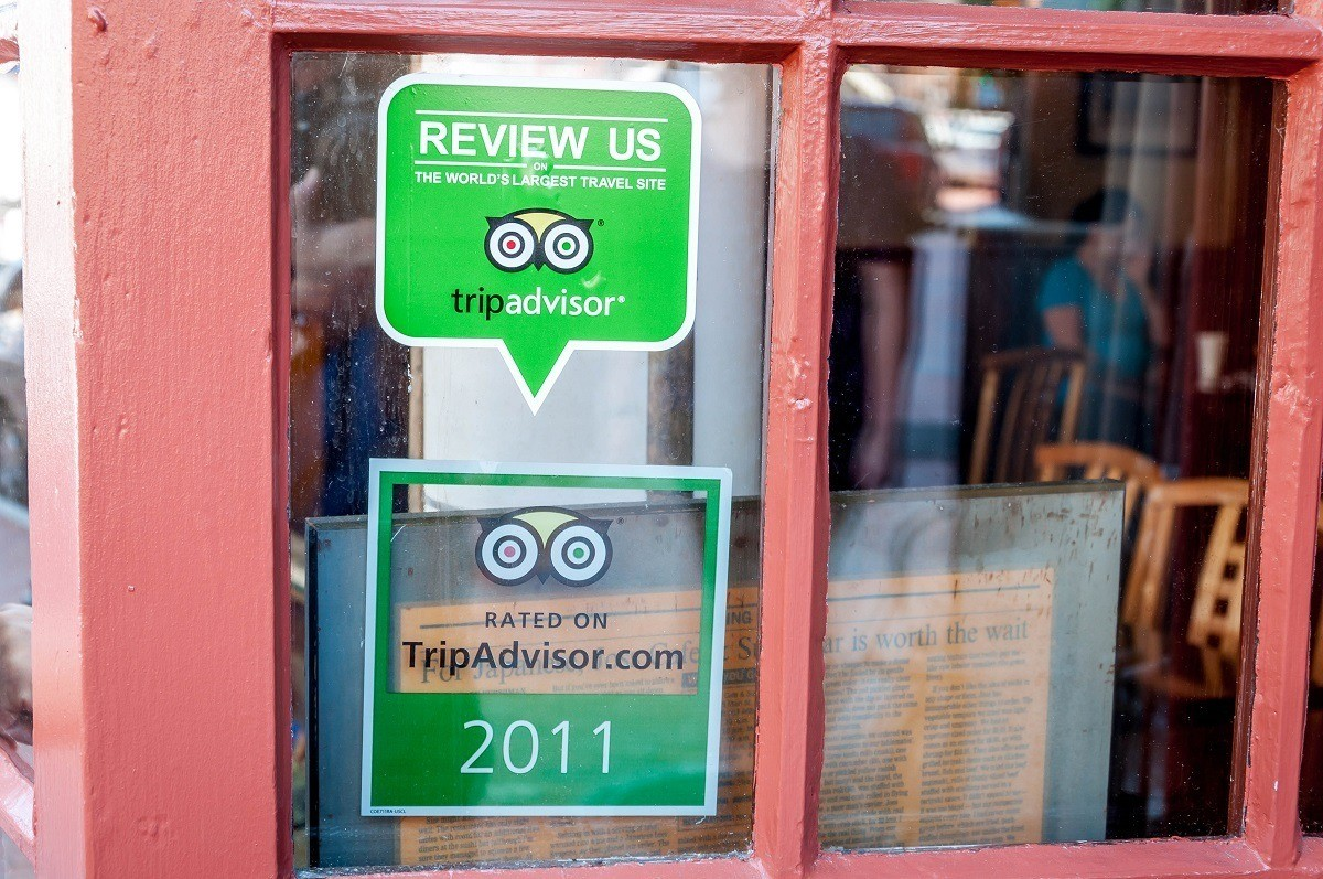 Decals in windows promoting TripAdvisor reviews