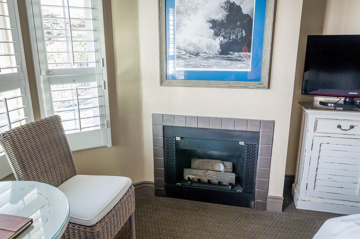 Each room has a sitting area with a fireplace and a TV