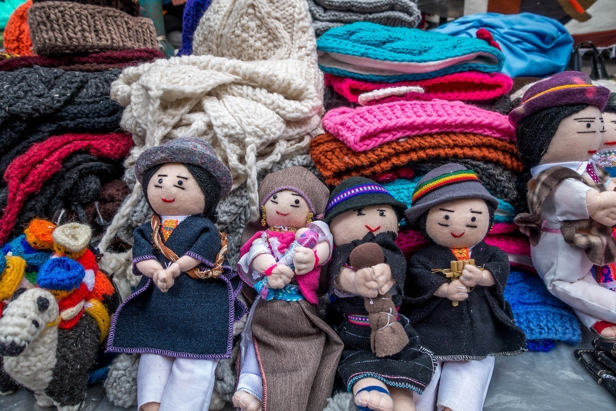 Souvenirs like wool knit hats and dolls are available