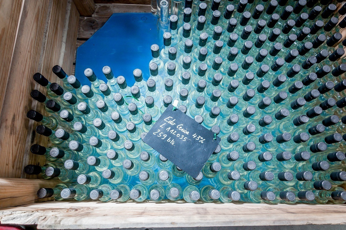 Crate of glass bottles for cherry brandy