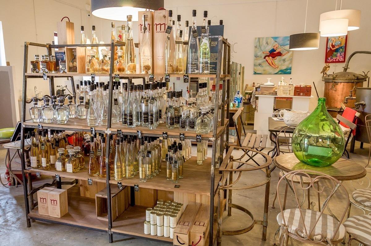Bottles of liqueurs on shelves at Manguin Distillery in Avignon, France