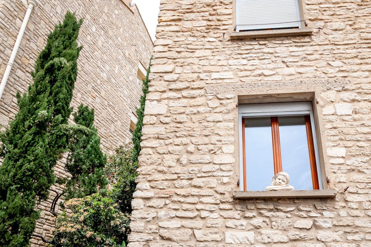 Statue of a girl in a window in Gordes. France