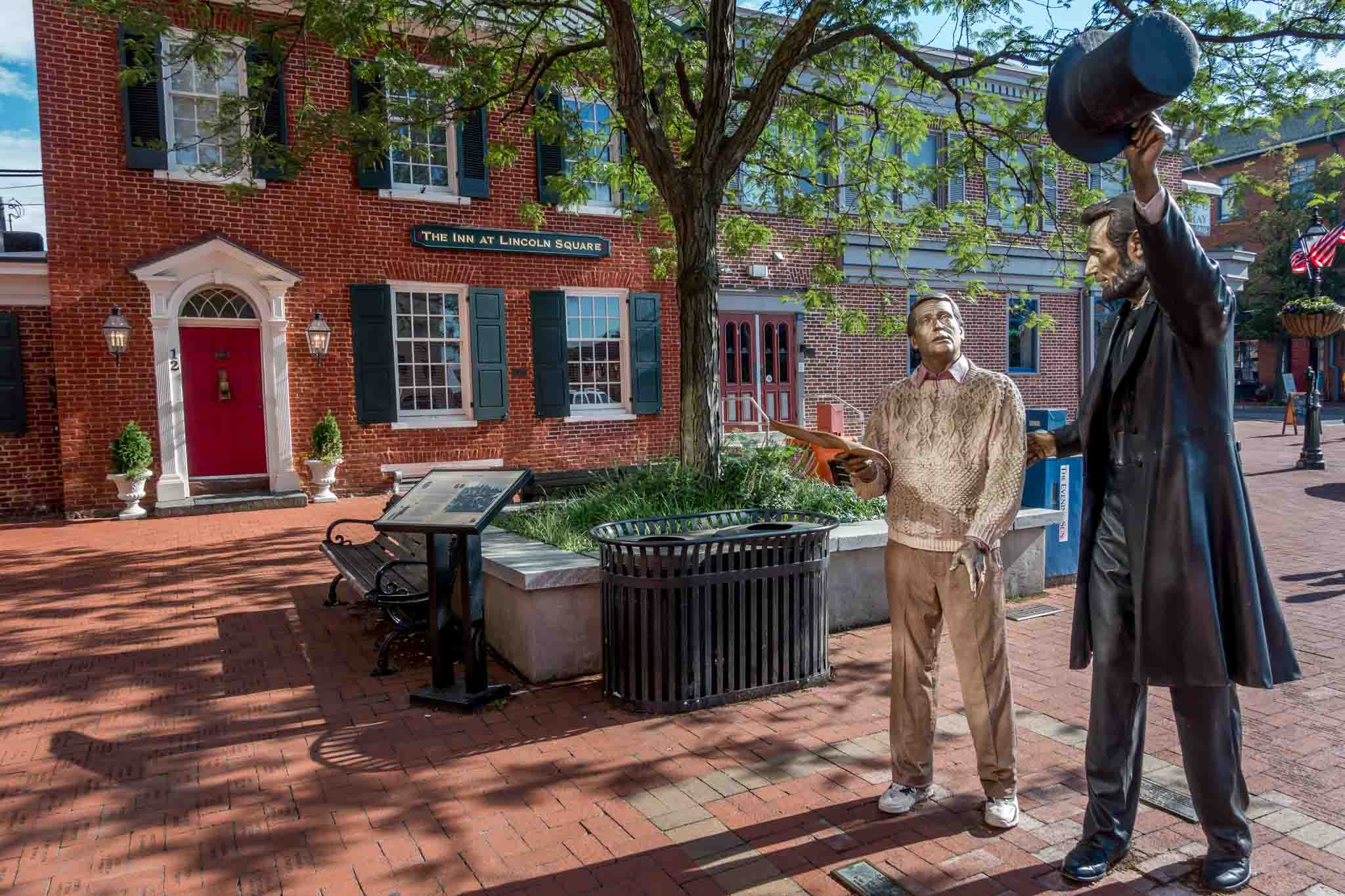 Statue of President Lincoln and a tourist