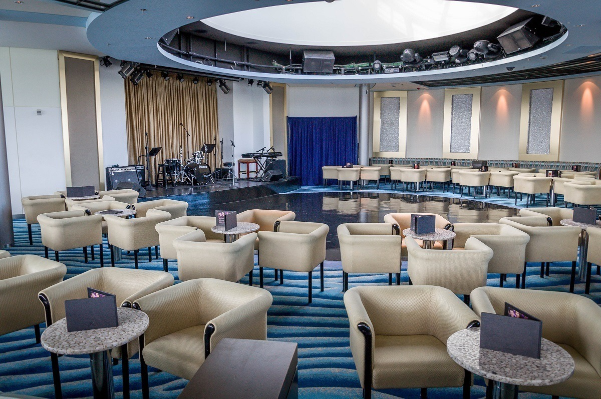 Large room with chairs and stage with drum kit