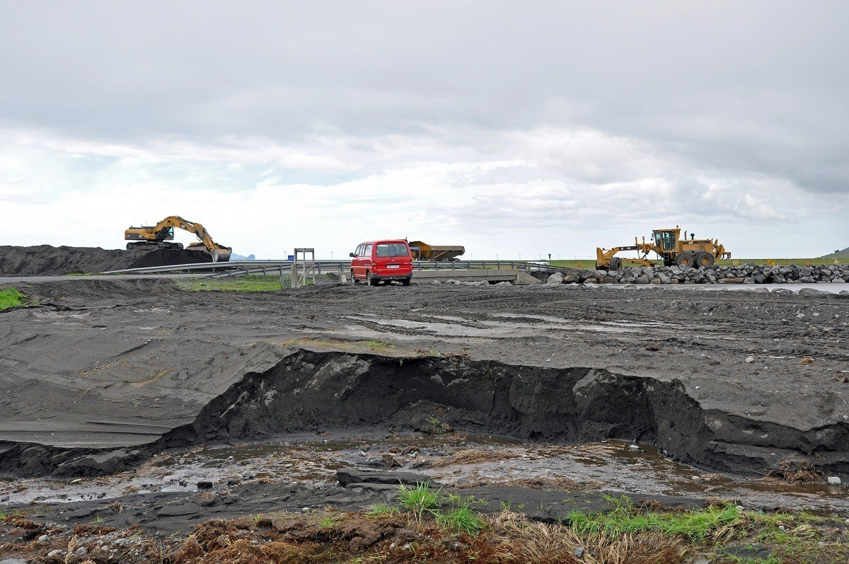 Earth movers removing volcanic ash from the Eyjafjallajokull eruption in Iceland