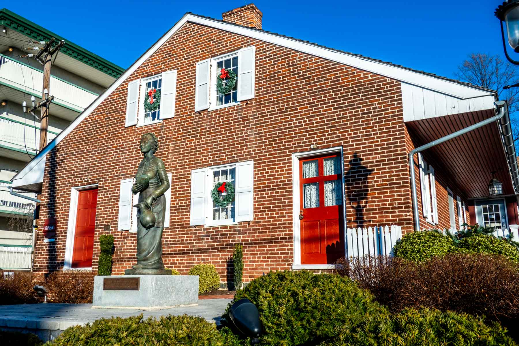 Brick house with a statue of Jennie Wade in front