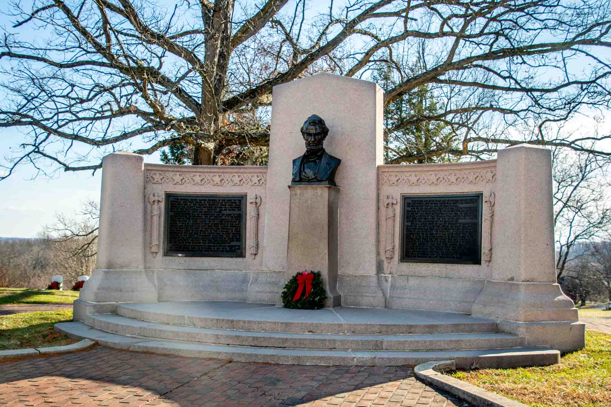 Stone memorial with bust of Abraham Lincoln at site of the Gettysburg Address