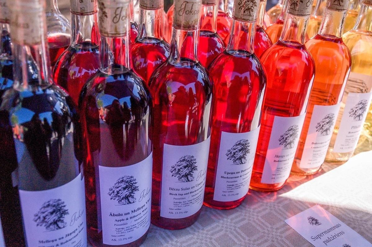 Bottles of colorful fruit wine
