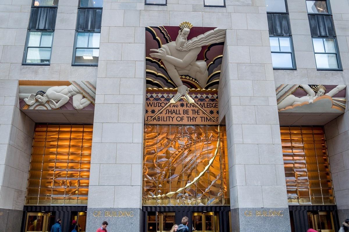 Art Deco sculpture of people over the doorway of a building