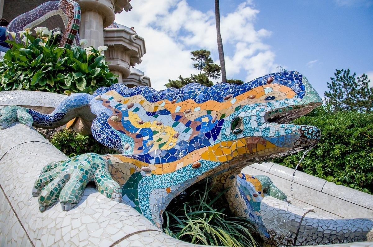 Fancy tile work in shape of  salamander at Park Guell in Barcelona