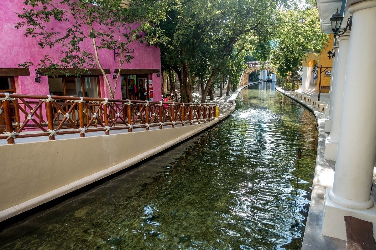 River running along the edge of the hotel lobby