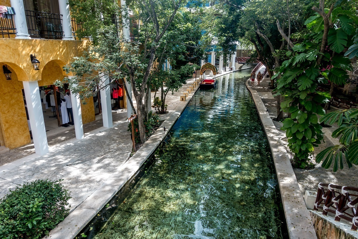 A river runs through the lobby of the Occidental Xcaret Riviera Maya