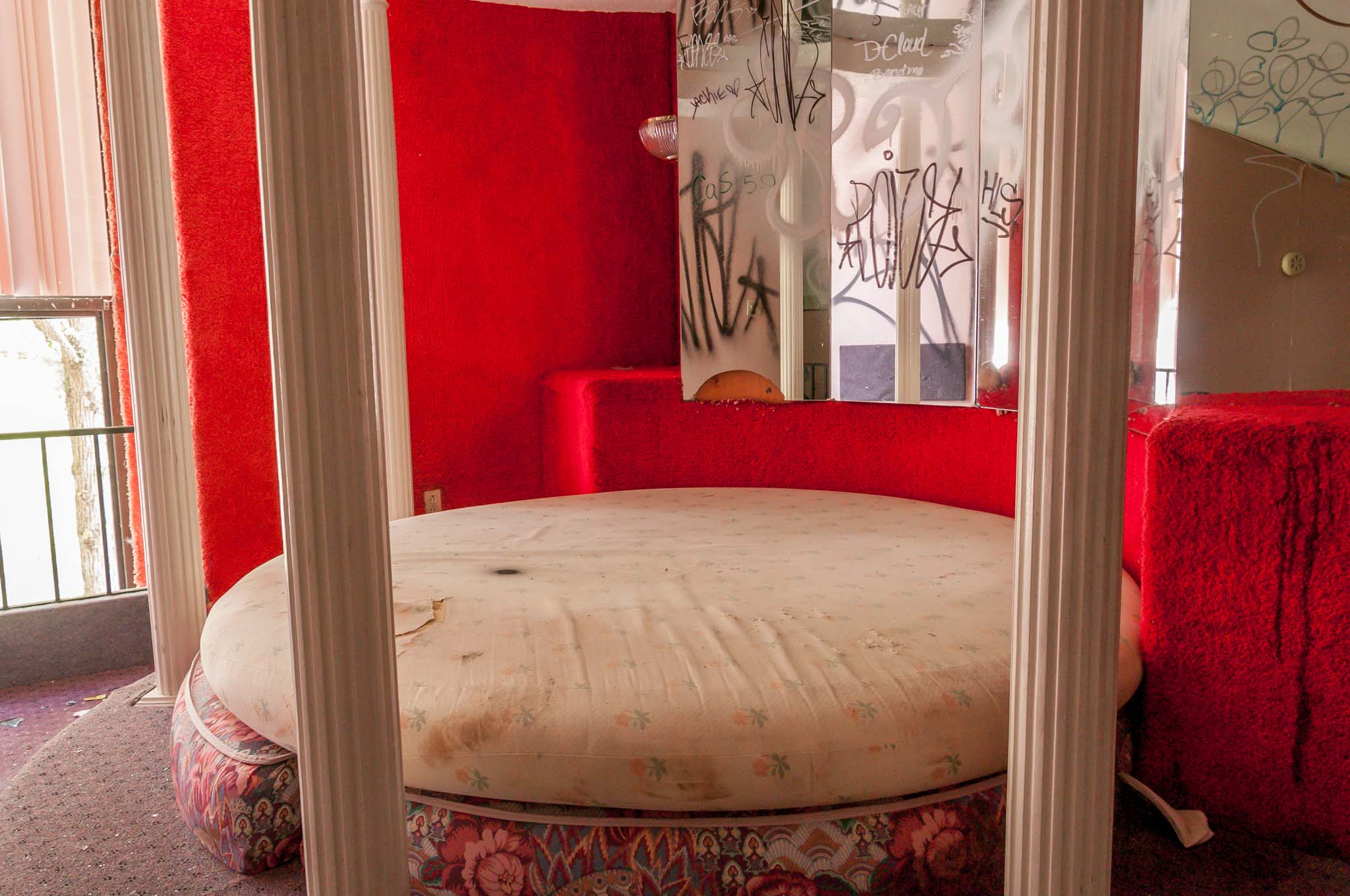 A round bed and mirrors in one of the Poconos love hotels