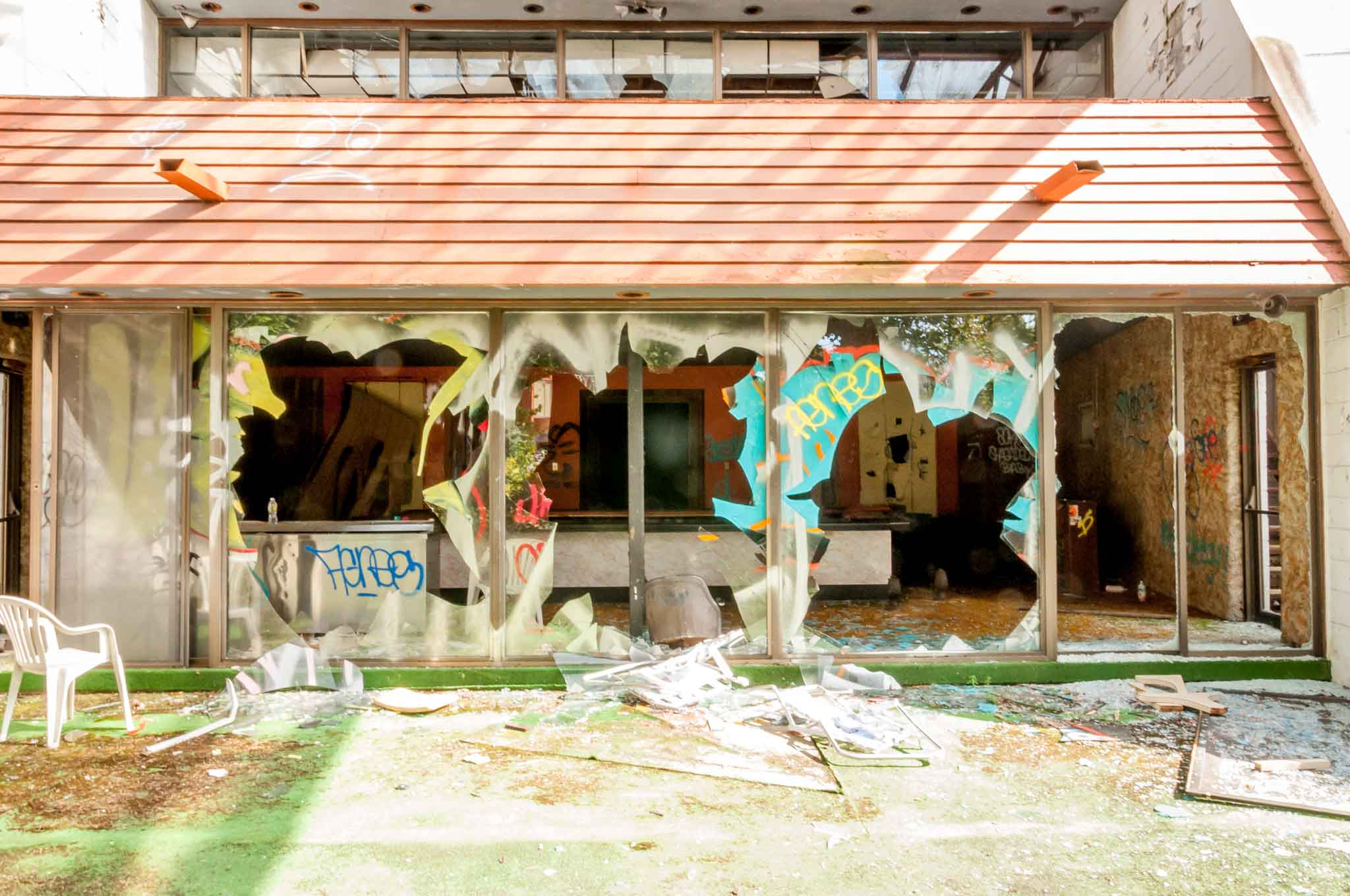 Vandalism and broken windows at an old hotel