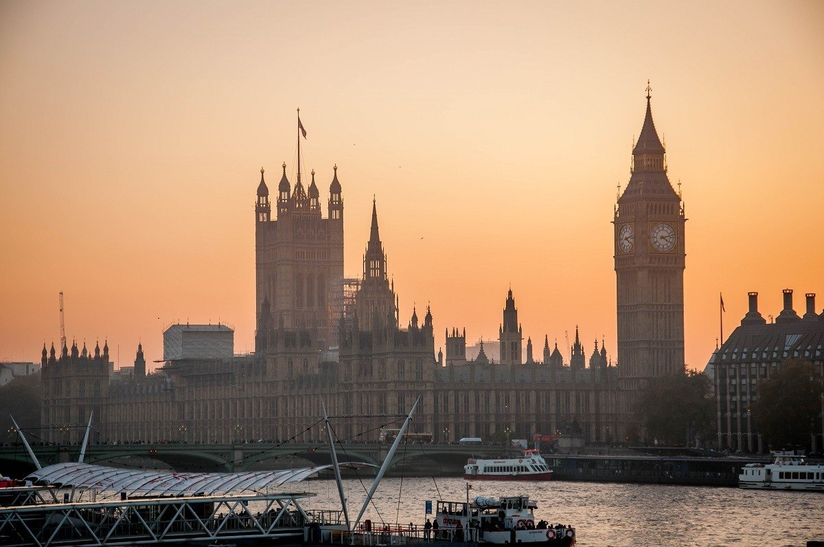 A view of Parliament on the Thames River at dusk