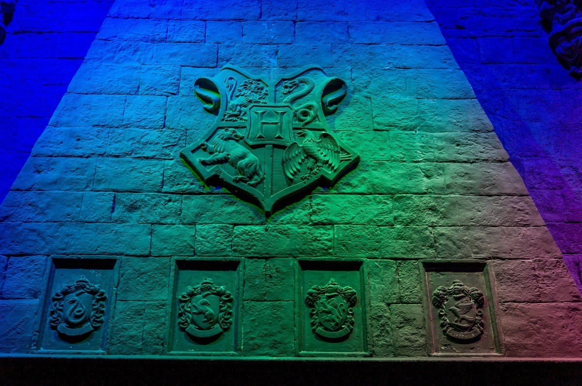 The fireplace in the Hogwarts Great Hall with House crests